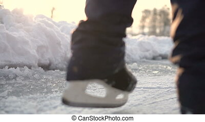 Amateur Ice Skater on Frozen Lake - Low section of amateur...