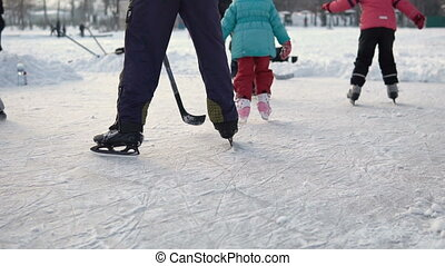 Amateur Skaters on Frozen Lake - Day shot of amateur skaters...