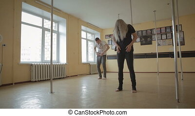 Girl and man dancing strip plastic in dance studio stock footage video