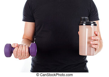 Young man holding a protein shake and a dumbbell - Close up...