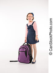 Schoolgirl standing with backpack