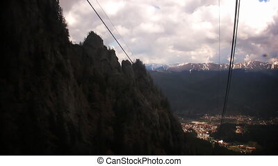 Cable car climbing on mountain