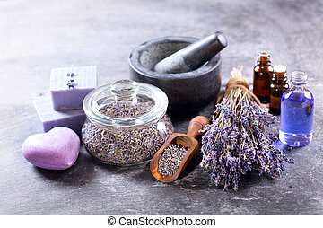 lavender spa products on dark background