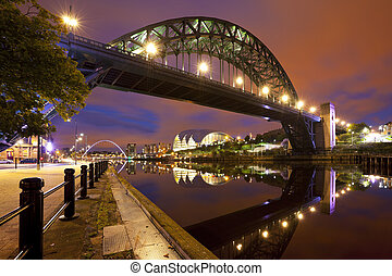 Bridges over the river Tyne in Newcastle, England at night -...
