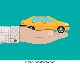 Hand with yellow car.