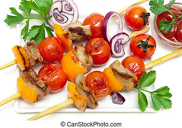 skewers of meat with vegetables and herbs on a white...