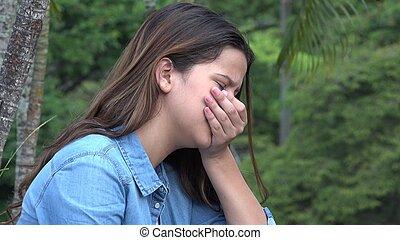 Hispanic Teen Girl Tearful With Emotional Pain