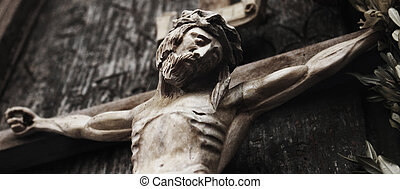 a wooden sculpture of crucified Jesus Christ (styled retro)...