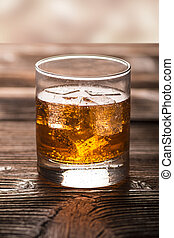 Aperitif with ice - Glass of aperitif with ice on a wooden...