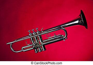 Gold Trumpet Isolated On Red