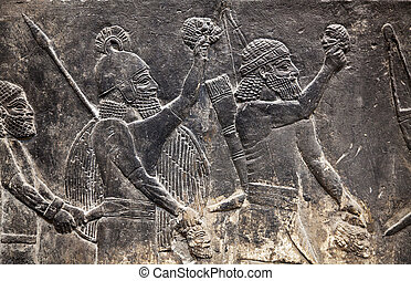 Ancient Assyrian wall carvings warriors with weapon