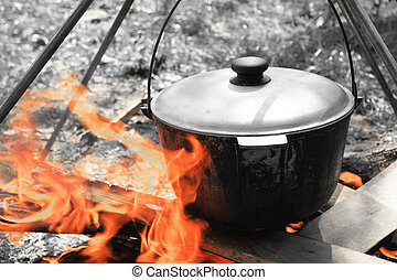 Pot for cooking on a fire / Black and white photo in retro...