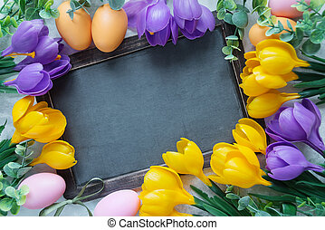 Easter card with old blank chalkboard surrounded by yellow...
