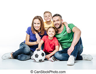 Happy family with soccer ball - Happy family in colored...