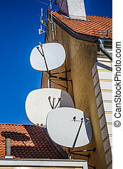 Satellite dish on the roof of an old building