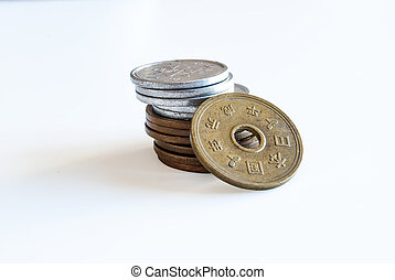 stack of Japanese coins isolated on white background