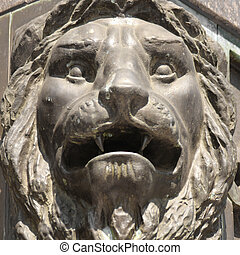 sculpture of a lion as a symbol of strength and greatness