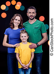 Happy family standing together - Portrait of happy family...