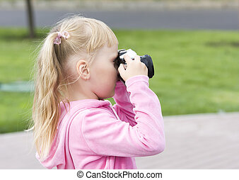 Little girl with the camera
