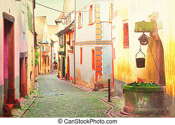 Riquewihr, beautiful town of Alsace, France - street of...