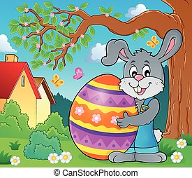 Bunny holding big Easter egg