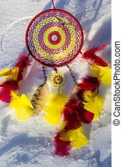 Dreamcatcher made of feathers, leather, beads, and ropes -...