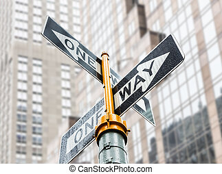 One Way Sign covered with raindrops. Streets of Manhattan in...