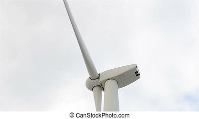 wind turbine generating electricity on cloudy sky