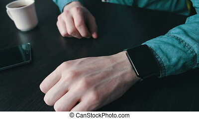 Young man using a smart watch