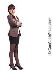 Full length of young business woman standing with arms folded