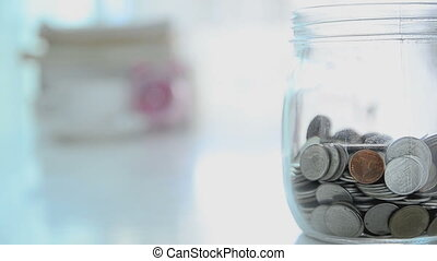 HD Falling of coins to glass jar concept to saving money...