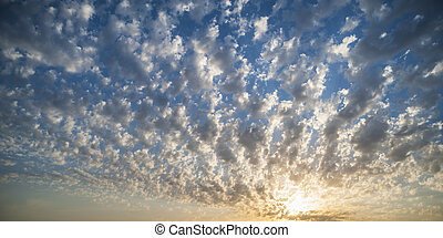 Sunset in fluffy clouds - Nice sunset with sky full of small...