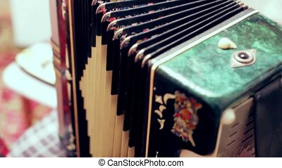 Russian singer plays the accordion. close-up shot.