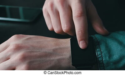 Young man using a smart watch - Young man in a stylish jeans...
