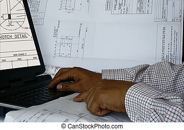 Computer Aided Design 2 - An engineer doing his design on...