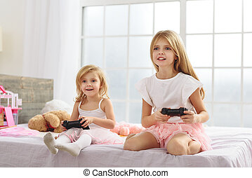 Sisters are crazy about the playstation - Enthusiastic kids...