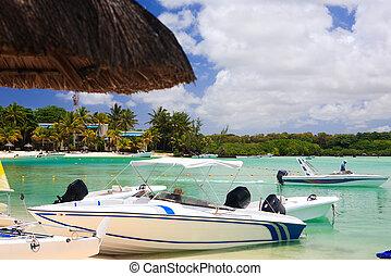 Boats at tropical beach resort - Some small boats at...