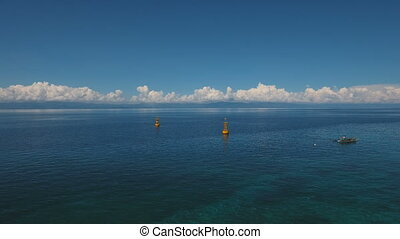 Orange buoy in the sea. - Orange buoy in the blue sea on a...