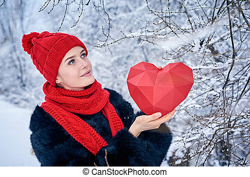 Love and valentines day concept. Portrait of woman holding...