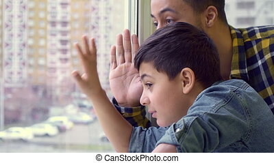 Boy and his father wave out the window - Attractive little...