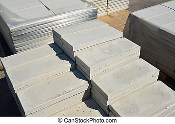 curbstone a folded in stacks - A curbstone a folded in a...