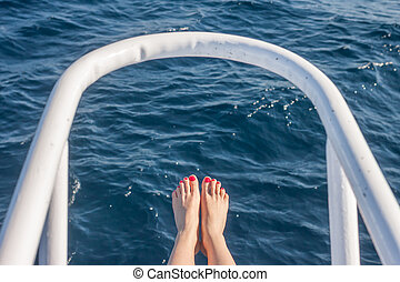 wooman feet on white yacht bow - vacation holiday wooman...