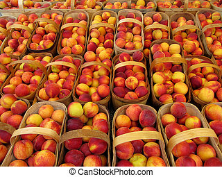 Baskets of peaches at a farmer's market.