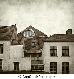 textured old paper background with Bruges buildings and...