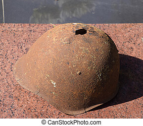 The old soldier's protective helmet. The helmet with a hole....
