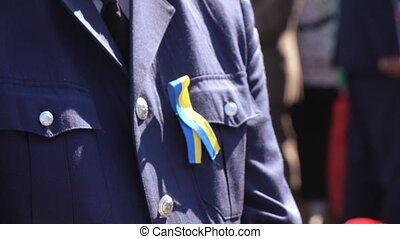Blue and yellow ribbon on chest police - In celebration of...