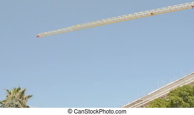 Crane at a skyscraper construction.