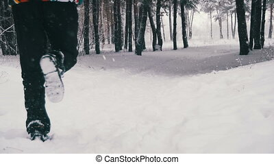 Jogging in the Winter Forest. Slow Motion