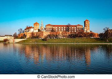 Famous landmark Wawel castle seen from Vistula, Krakow,...