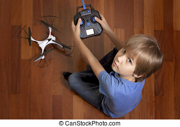 Little kid is going to play with the quadcopter drone at...